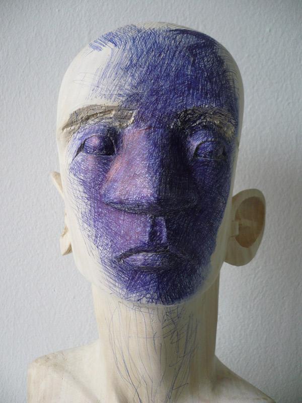 Rautenstrauch: Kopf mit Kugelschreiber